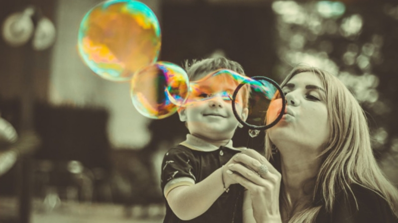 Mom and Child Blowing Bubles Final