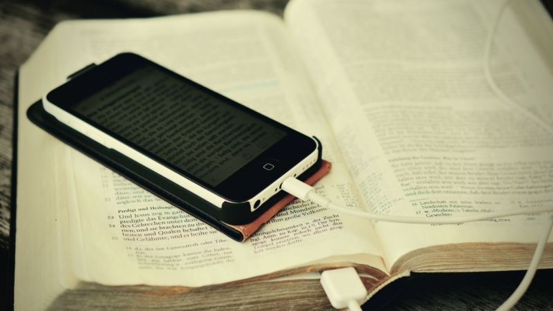 Bible with a mobile phone